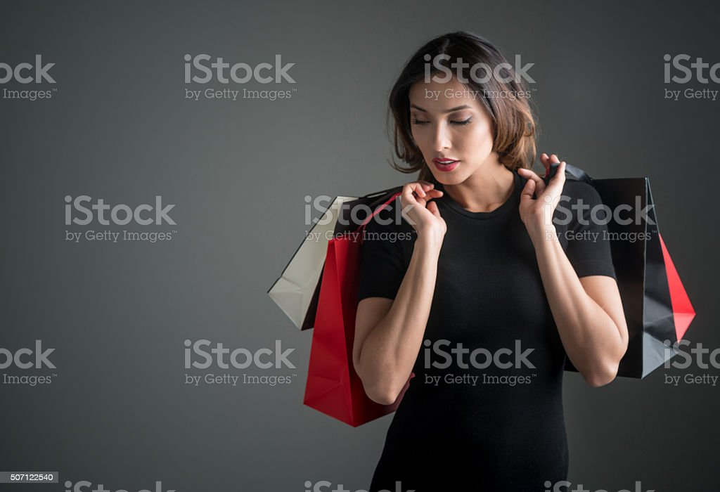 Beautiful model with shopping bags stock photo