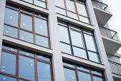 Beautiful modern apartment house. Rectangular windows reflect co