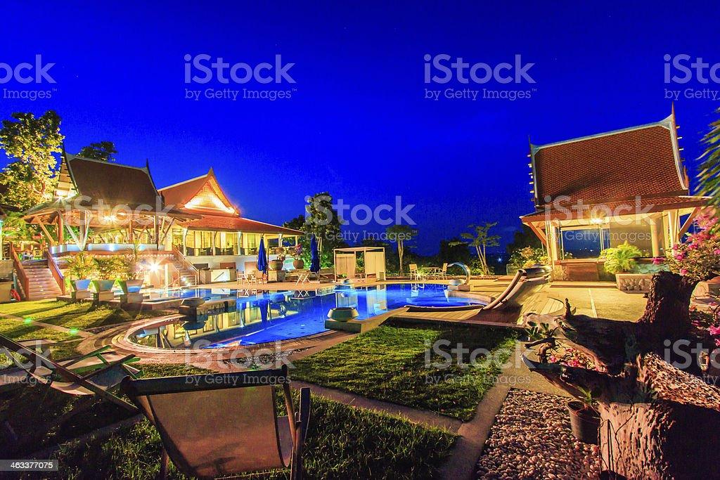 Beautiful modern getaway resort with pool at night stock photo