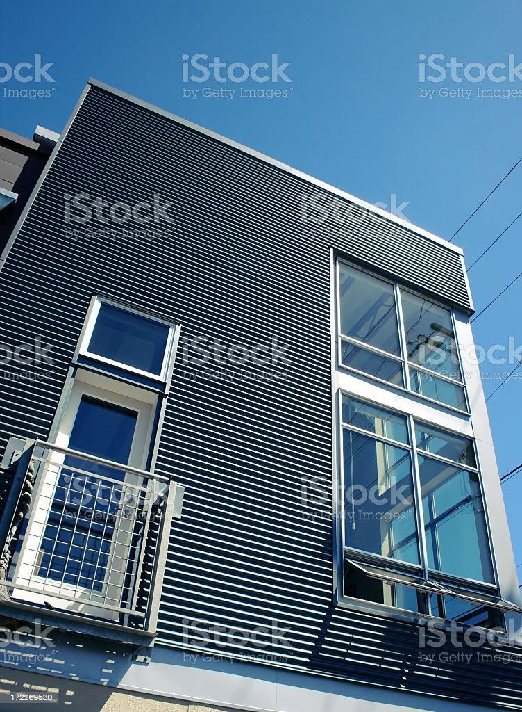 A beautiful modern home with a corner stylish window stock photo