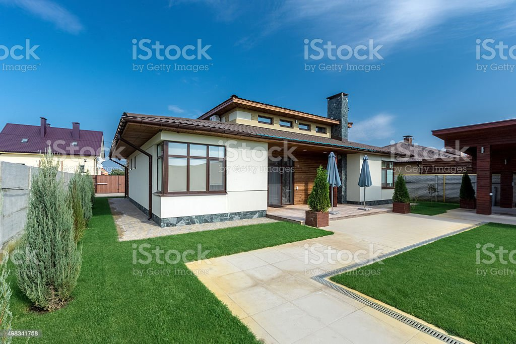 Beautiful modern house in cement, view from the garden stock photo