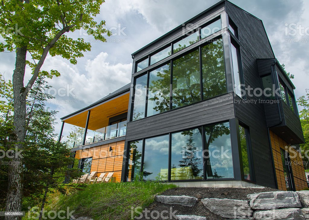 Beautiful modern house in the forest, outdoor stock photo