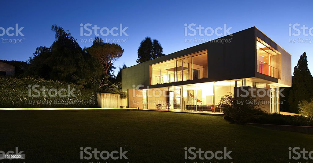 beautiful modern house outdoors at night royalty-free stock photo
