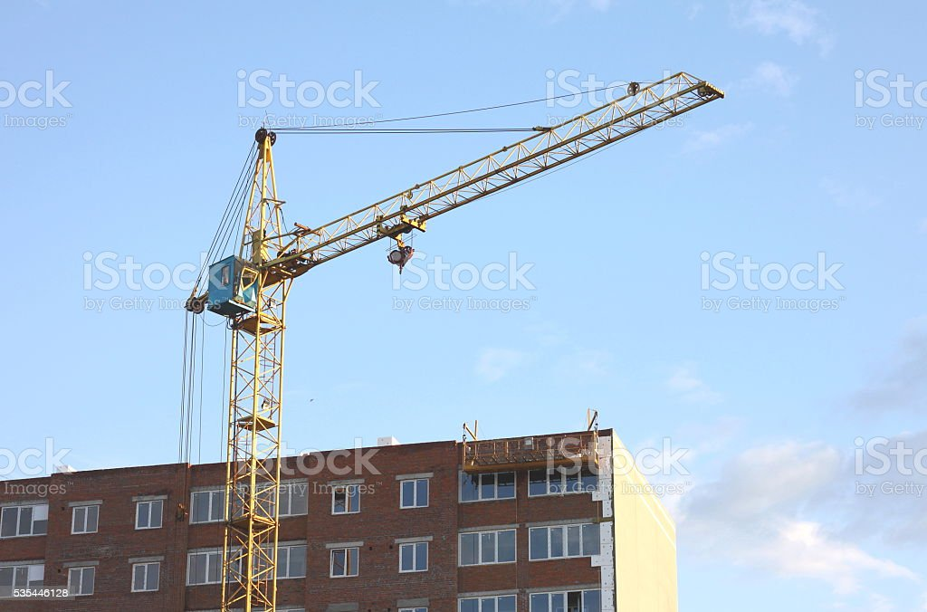 beautiful modern multistory building with construction crane stock photo