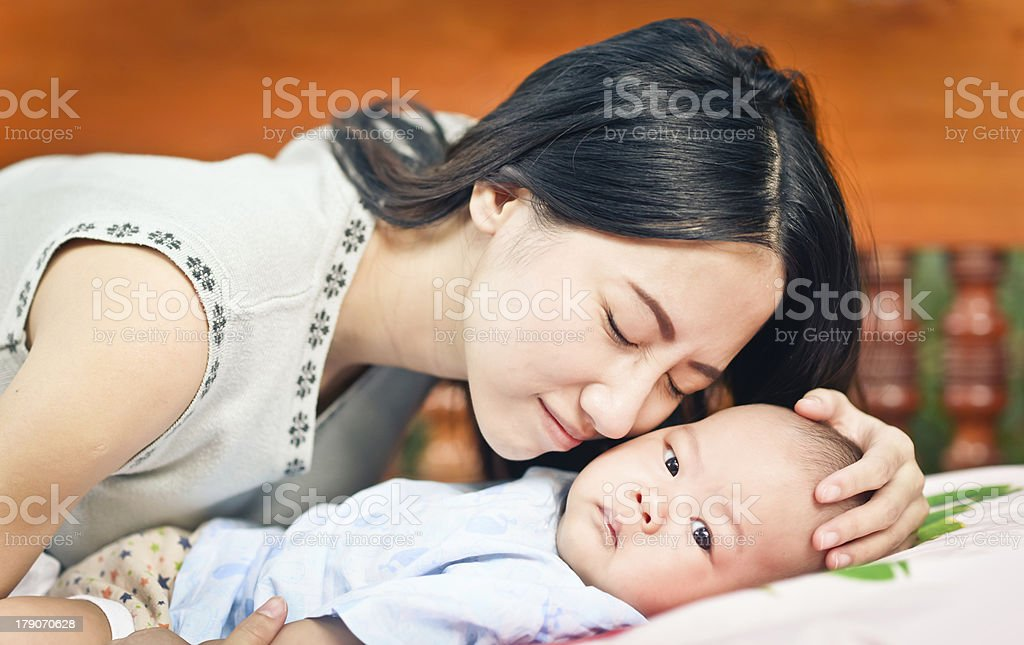 Beautiful mom holding her cute baby. royalty-free stock photo