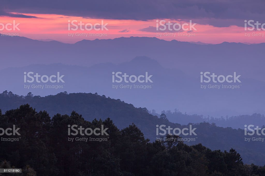 Beautiful morning before sunrise on top of the mountain stock photo