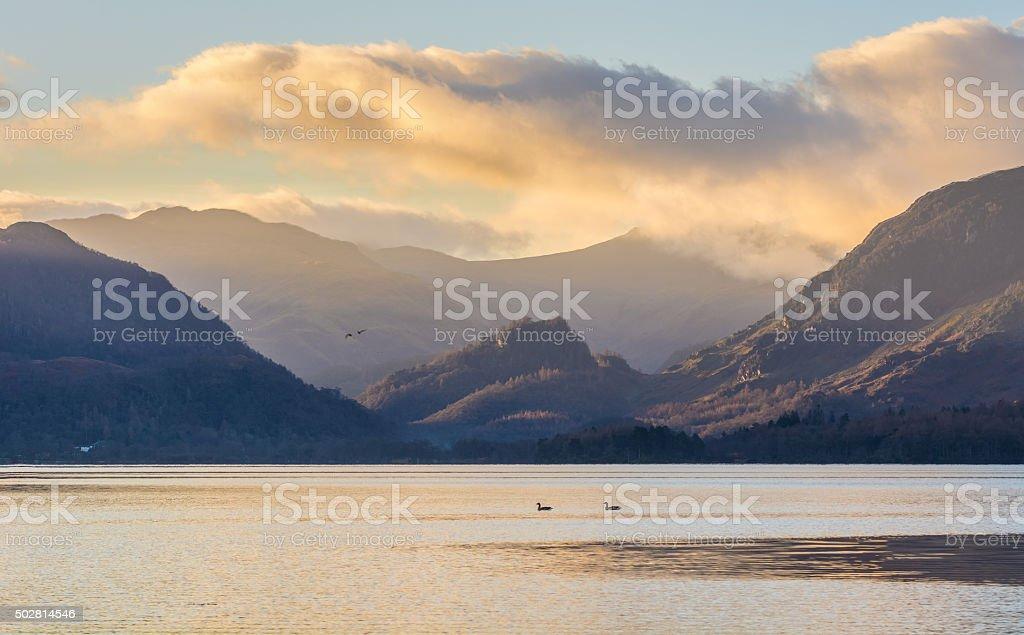 Beautiful Morning Light Shining Through Mountains In The Lake District. stock photo