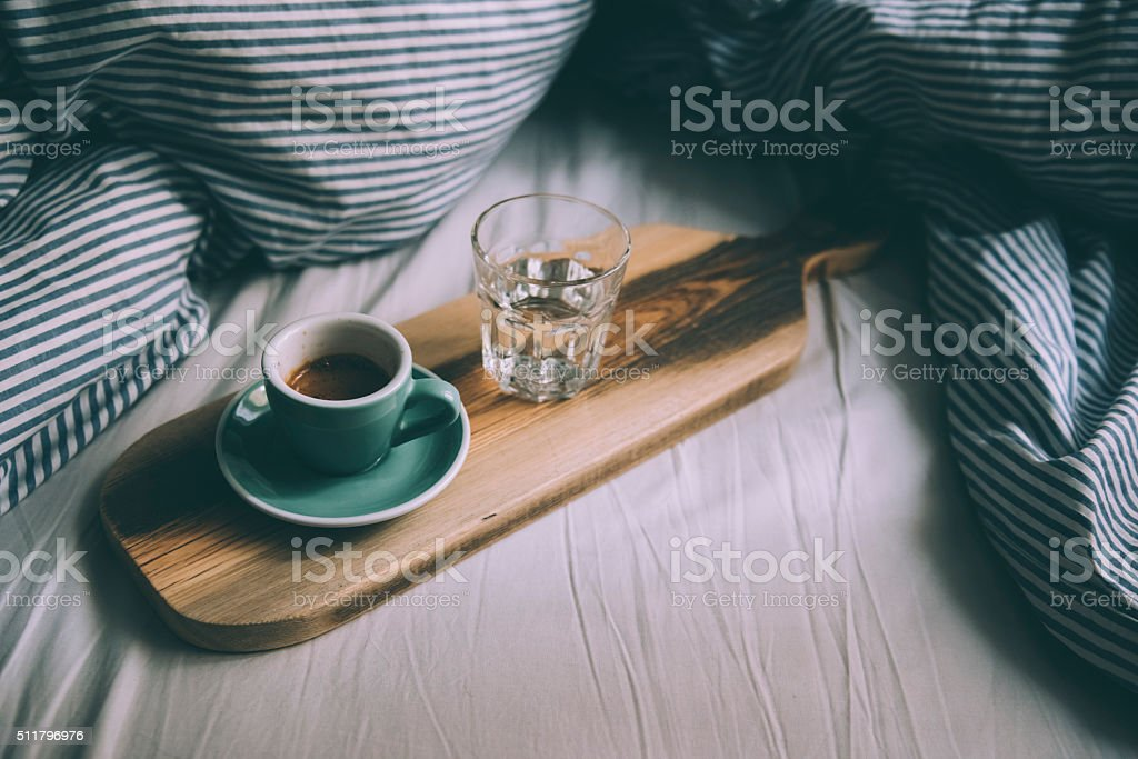 Beautiful morning working in bed essentials stock photo