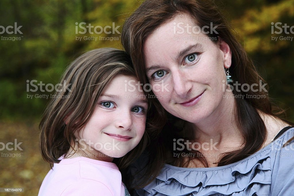 Beautiful Mother and Daughter Looking at Camera stock photo