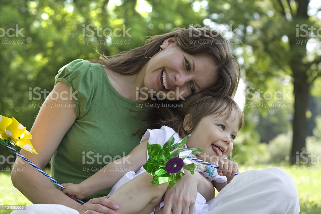 Beautiful mother and daughter playing together stock photo