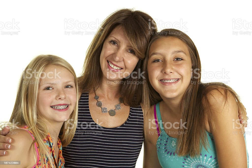 Beautiful Mother and Daughters on White Background. royalty-free stock photo
