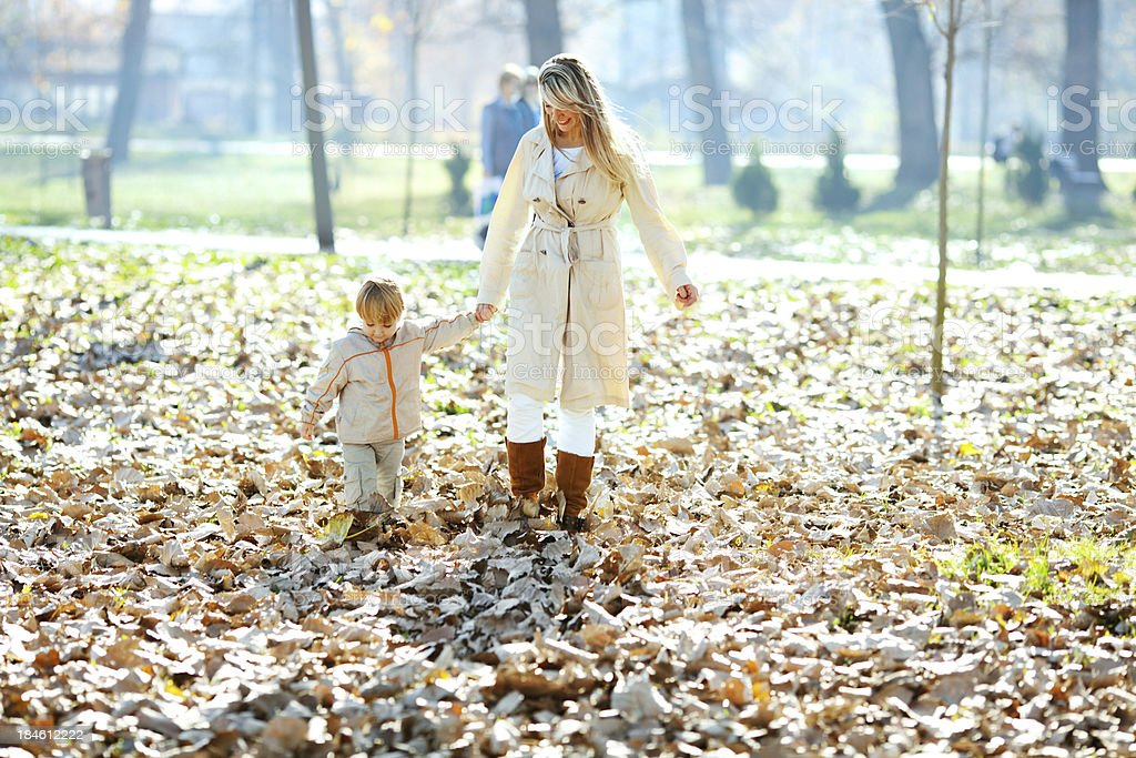 Beautiful mother and son taking a walk in park. royalty-free stock photo