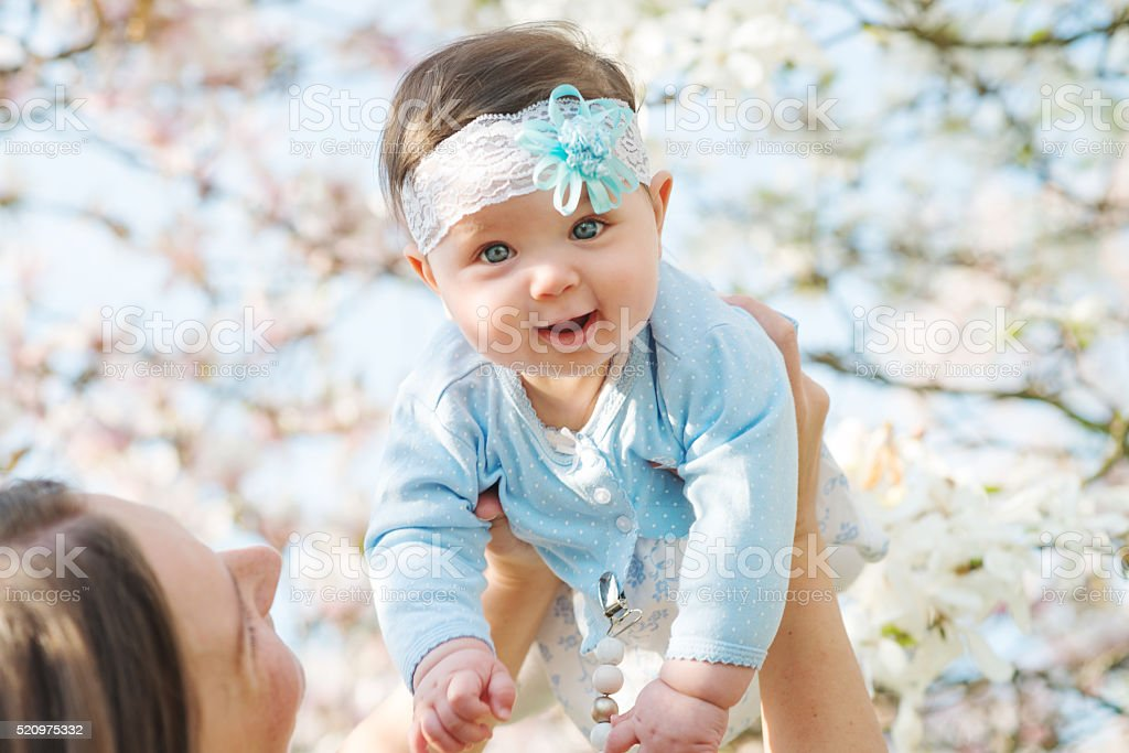 Beautiful mother posing with her little cute baby stock photo