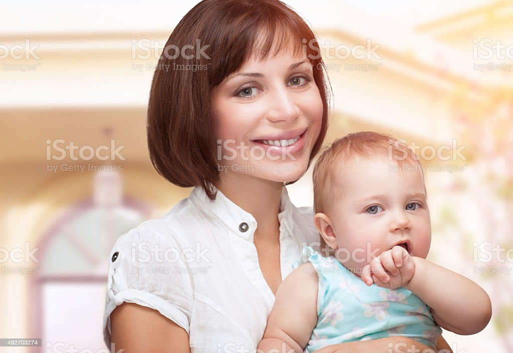 Beautiful mother with baby stock photo