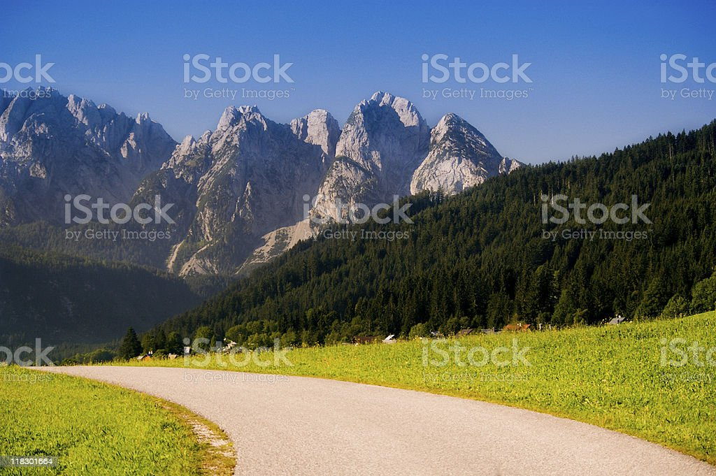 beautiful mountain peaks and ridge with road in morning light royalty-free stock photo