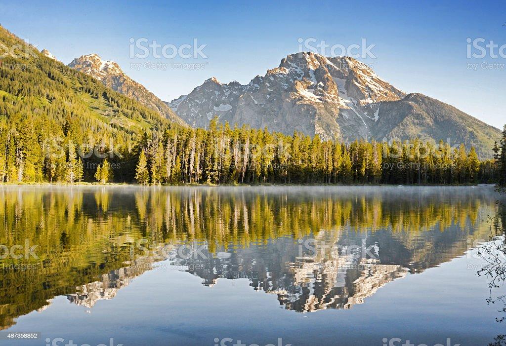 Beautiful mountain reflections in Yellowstone Lake. stock photo