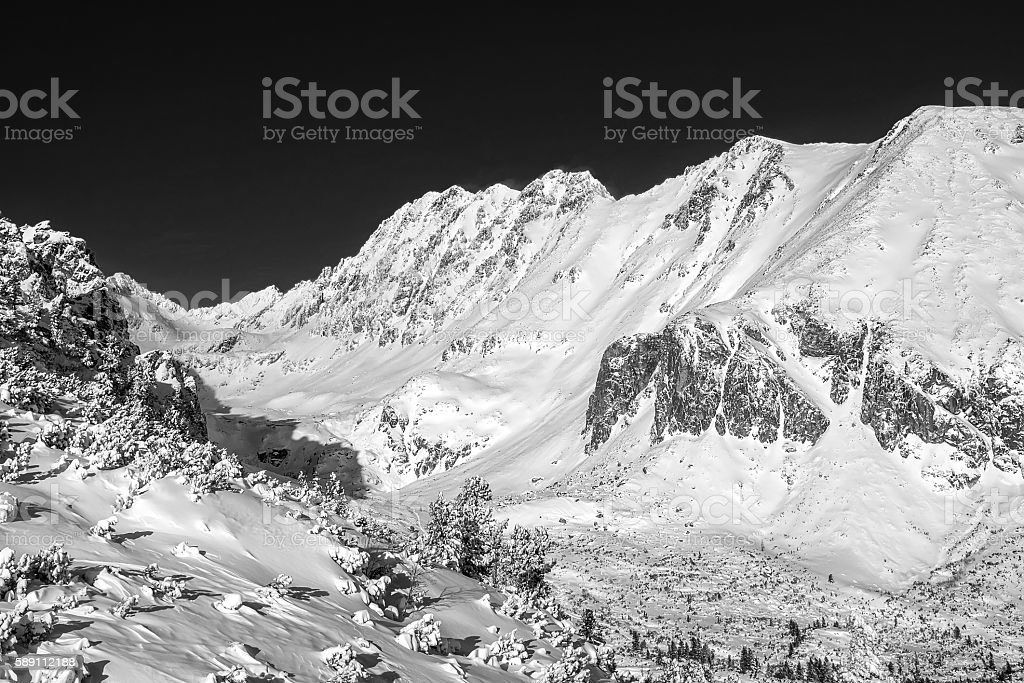 Beautiful mountains view at winter under sky. stock photo