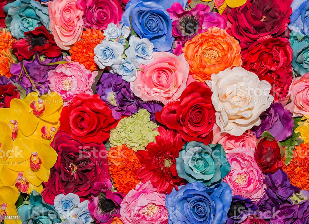 Beautiful multicolored artificial flowers background. stock photo