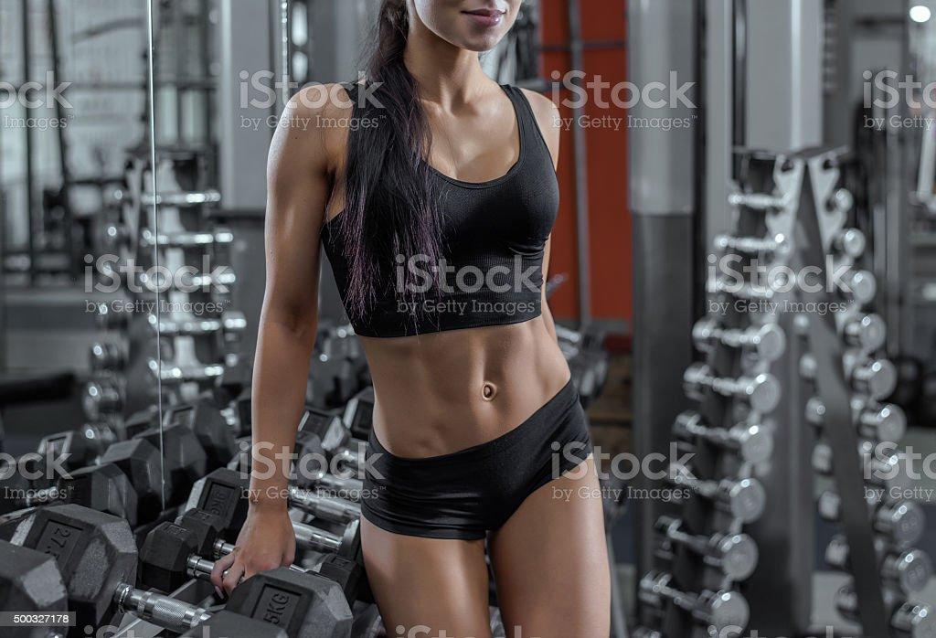 Beautiful muscular fit woman stock photo