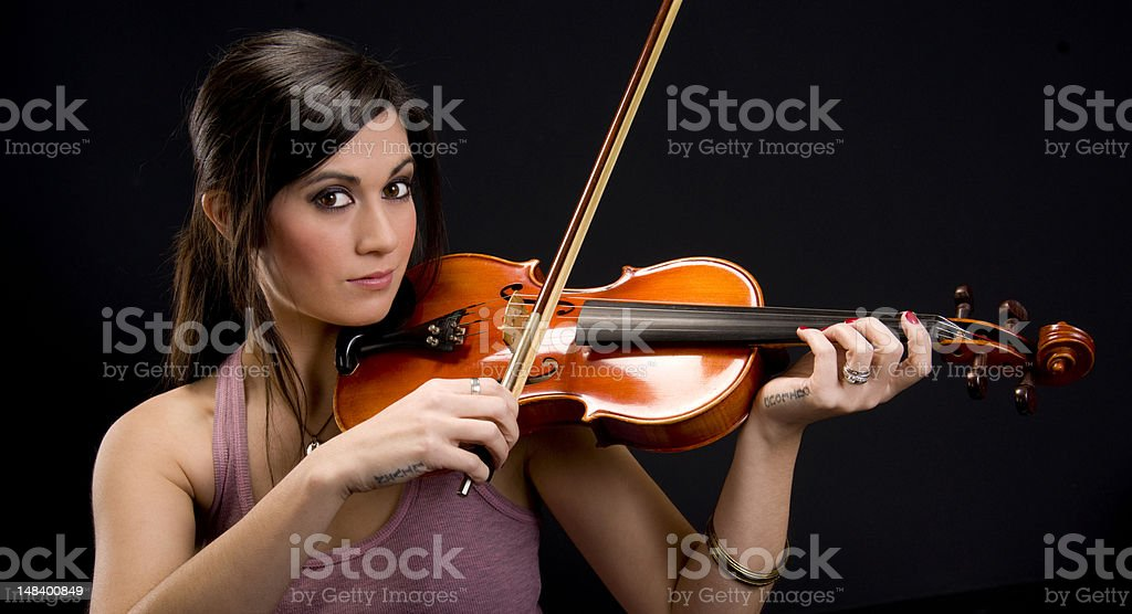 Beautiful Music Maker Woman Plays Violin with Bow stock photo