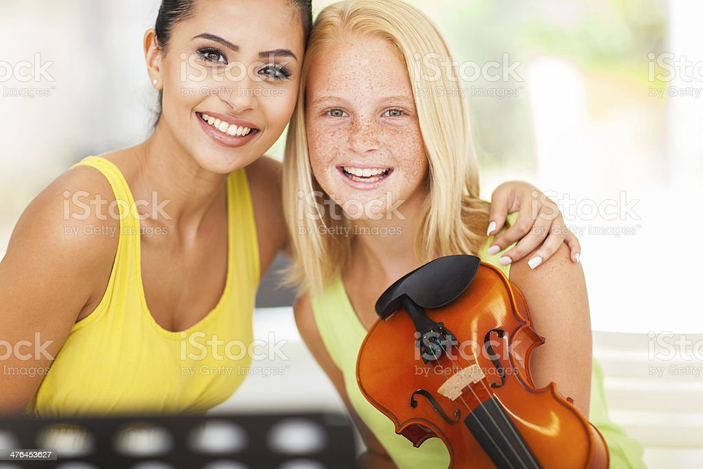 beautiful music teacher with violin student royalty-free stock photo
