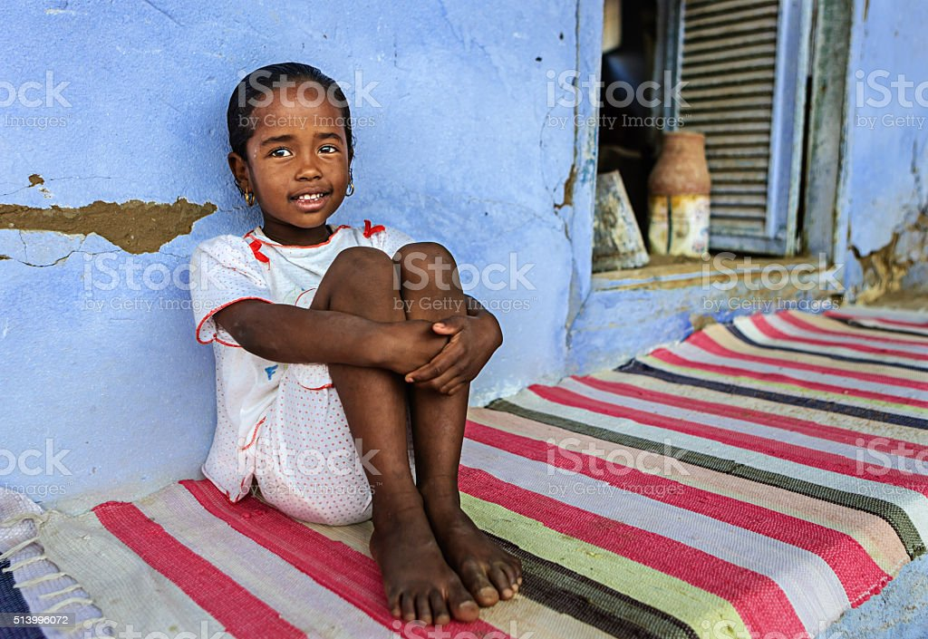Beautiful Muslim girl resting in her house, Southern Egypt stock photo