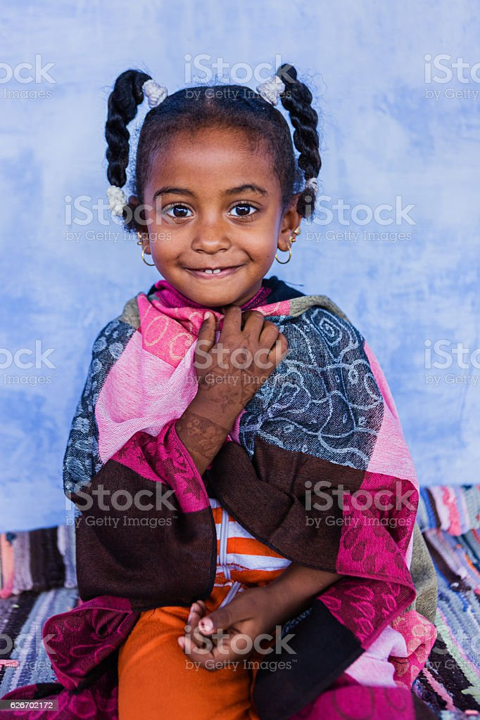 Beautiful Muslim little girl in Southern Egypt stock photo
