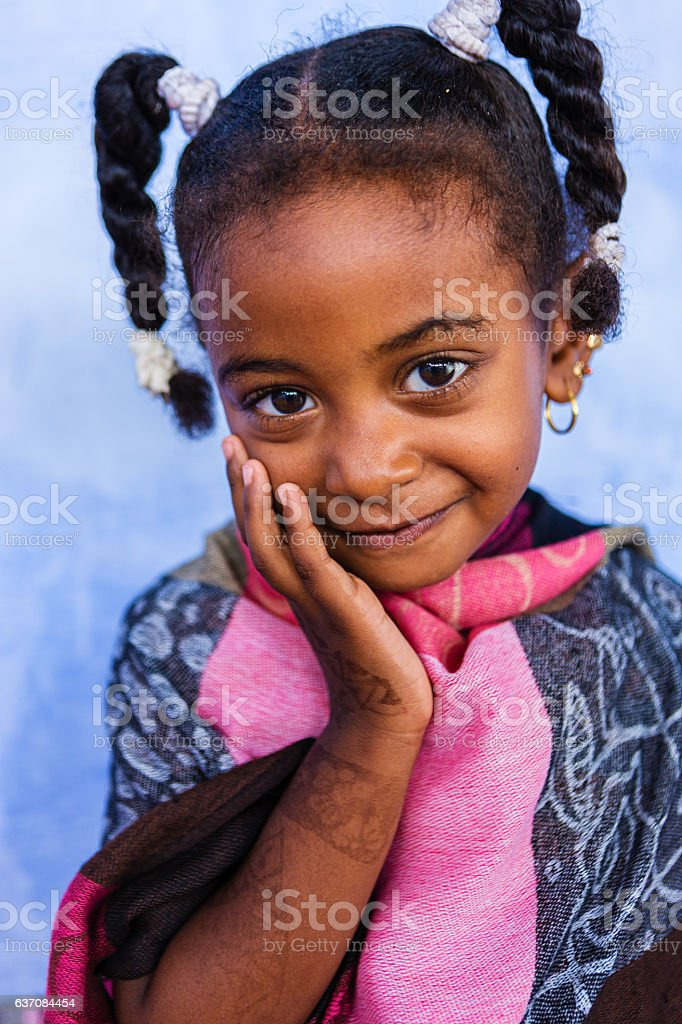Beautiful Muslim little girl in Southern Egypt stock photo