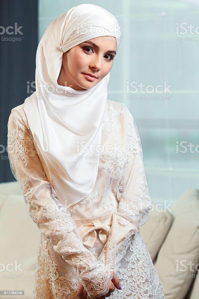 beautiful Muslim woman in a white wedding dress stock photo