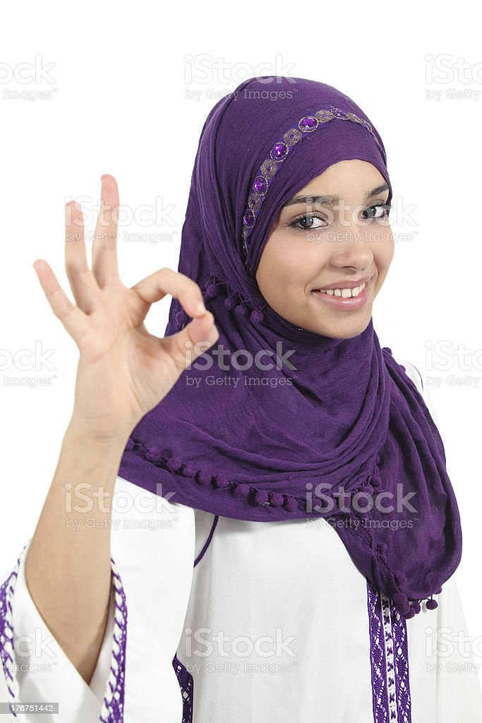 Beautiful muslim woman wearing a jellaba gesturing ok royalty-free stock photo