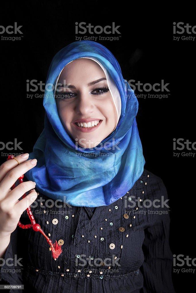beautiful muslim woman wearing hijab holding rosary / tespih royalty-free stock photo