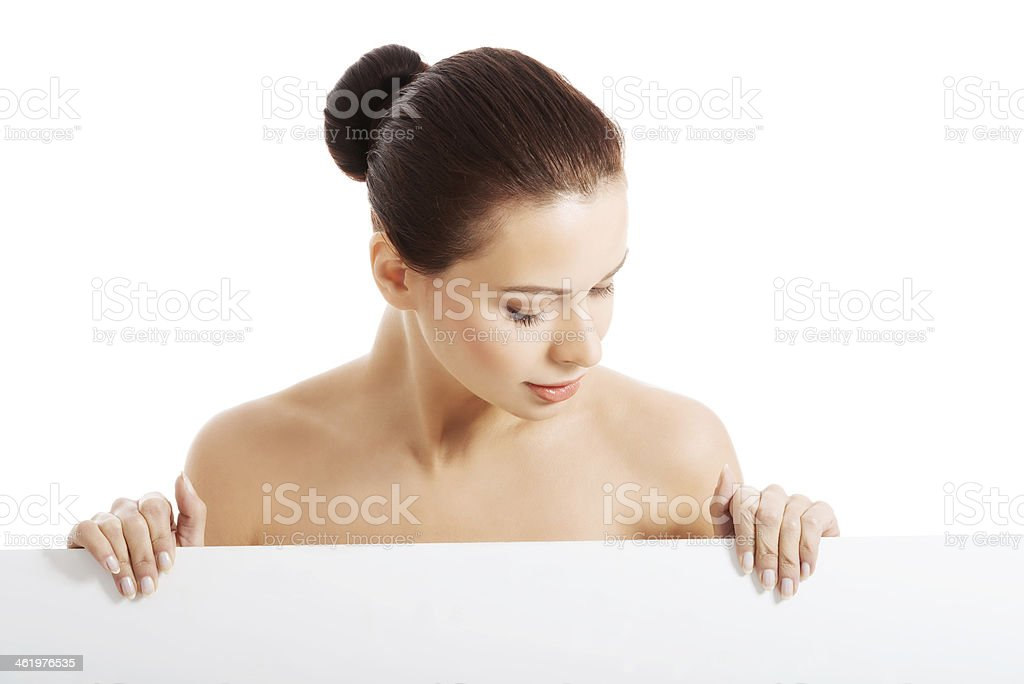 Beautiful naked woman holding copy space. royalty-free stock photo