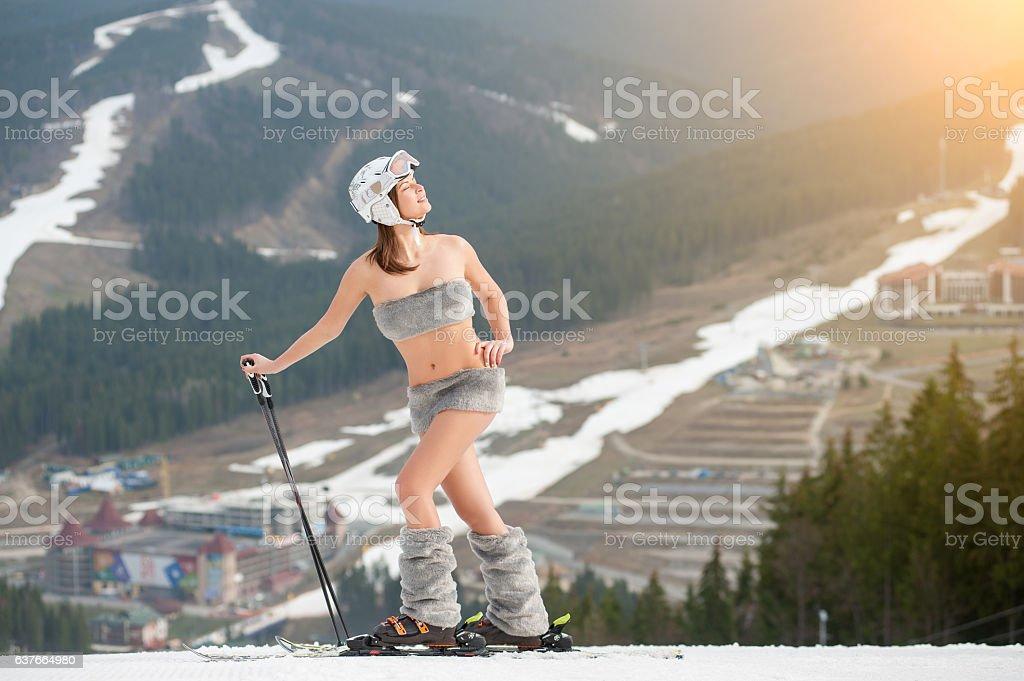 Beautiful naked woman skier is enjoying the spring sun stock photo