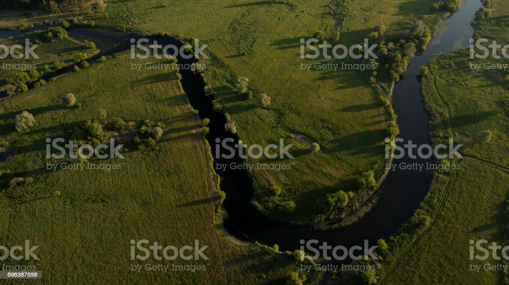 A beautiful narrow and winding river view from above. stock photo