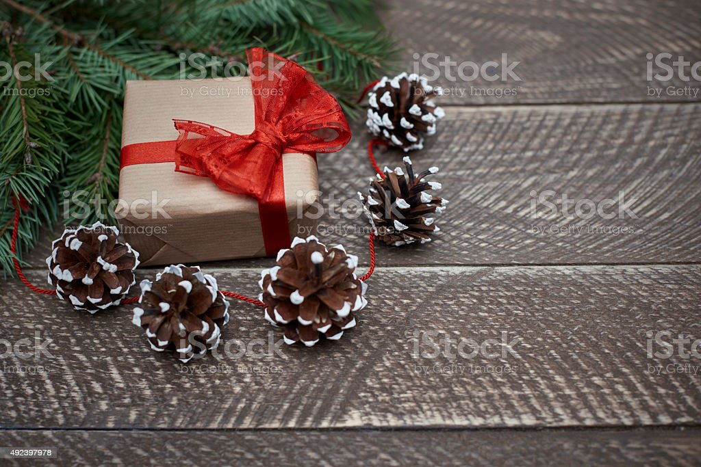 Beautiful natural christmas ornaments and a gift stock photo