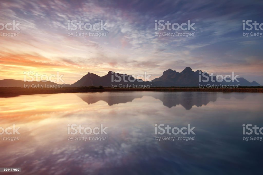 Beautiful natural of the colorful sky and beautiful water reflection,during the time sunrise at Khao Sam Roi Yot National Park,Prachuap Khiri Khan Province in Thailand. Travel and natural Concept stock photo