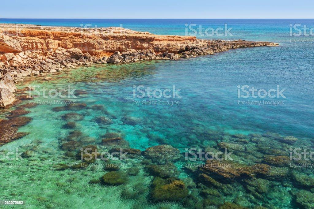 Beautiful natural rock arch near of Ayia Napa, Cavo Greco and Protaras on Cyprus island, Mediterranean Sea. View near of Legendary bridge lovers. Amazing blue green sea and sunny day. stock photo