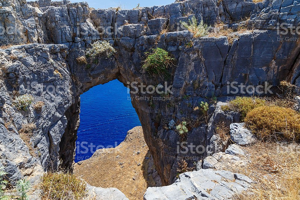 Beautiful natural rock arch sea and sunny day. stock photo