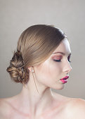 Beautiful natural woman with professional makeup and hair