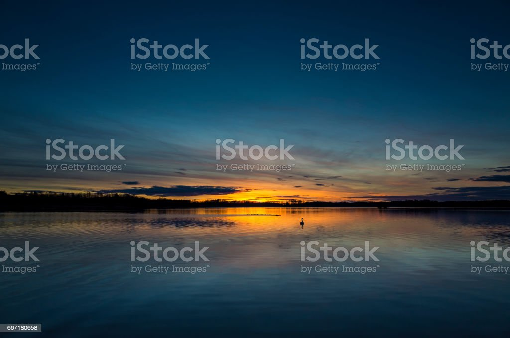 Beautiful nature and landscape photo of colorful sunset at a lake in Sweden stock photo