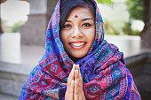 beautiful nepalese woman  performing namaste gesture