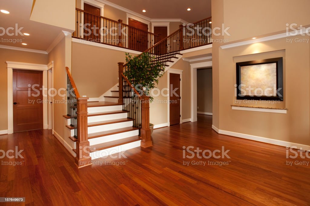 Beautiful new home interior hardwood floors and huge staircase royalty-free stock photo