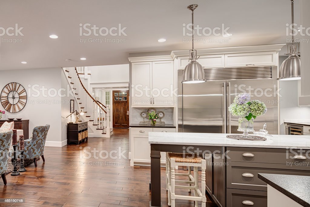 Beautiful New Kitchen and Living Room in New Luxury Home stock photo