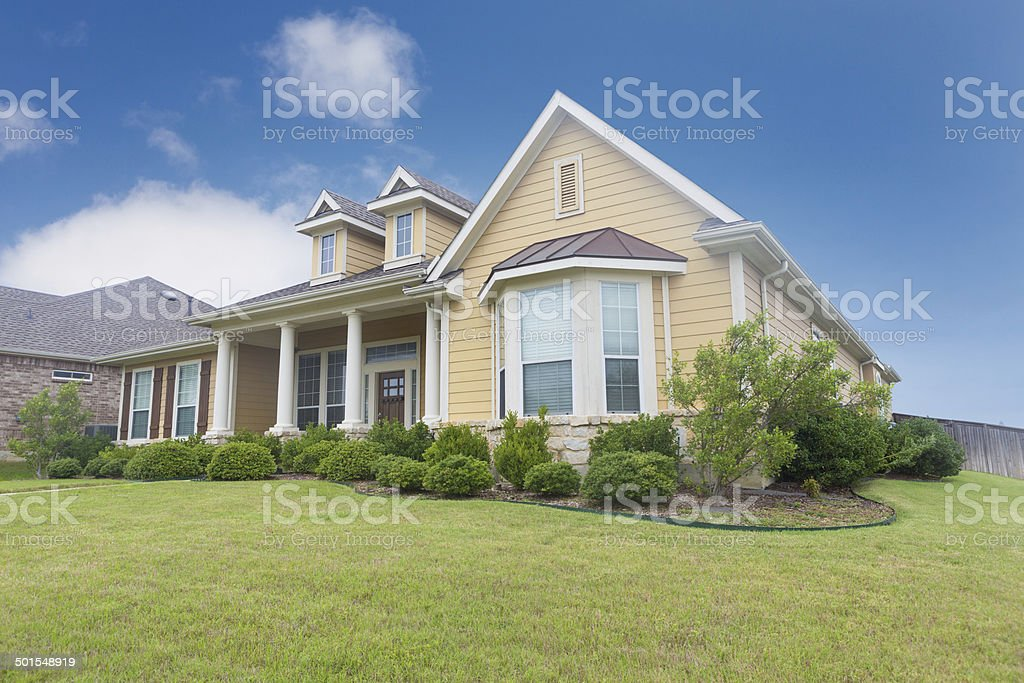 Beautiful newly constructed home with landscaped yard stock photo