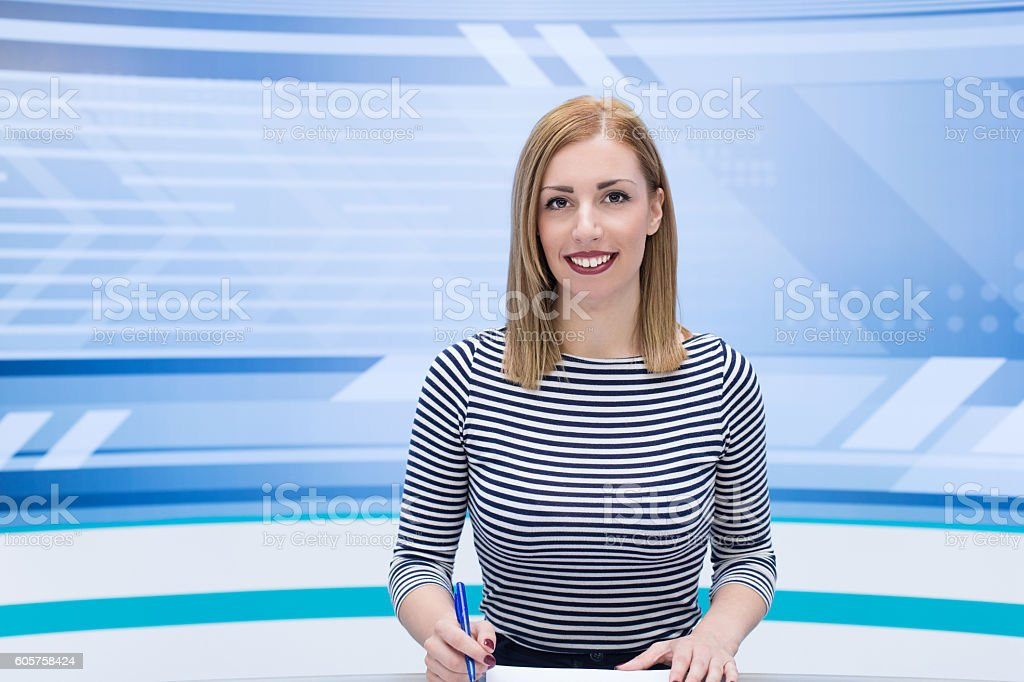 Beautiful newscaster ready for news stock photo