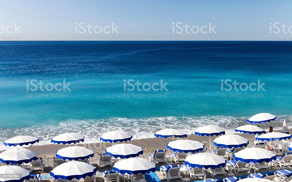 Beautiful Nice beach with umbrellas stock photo