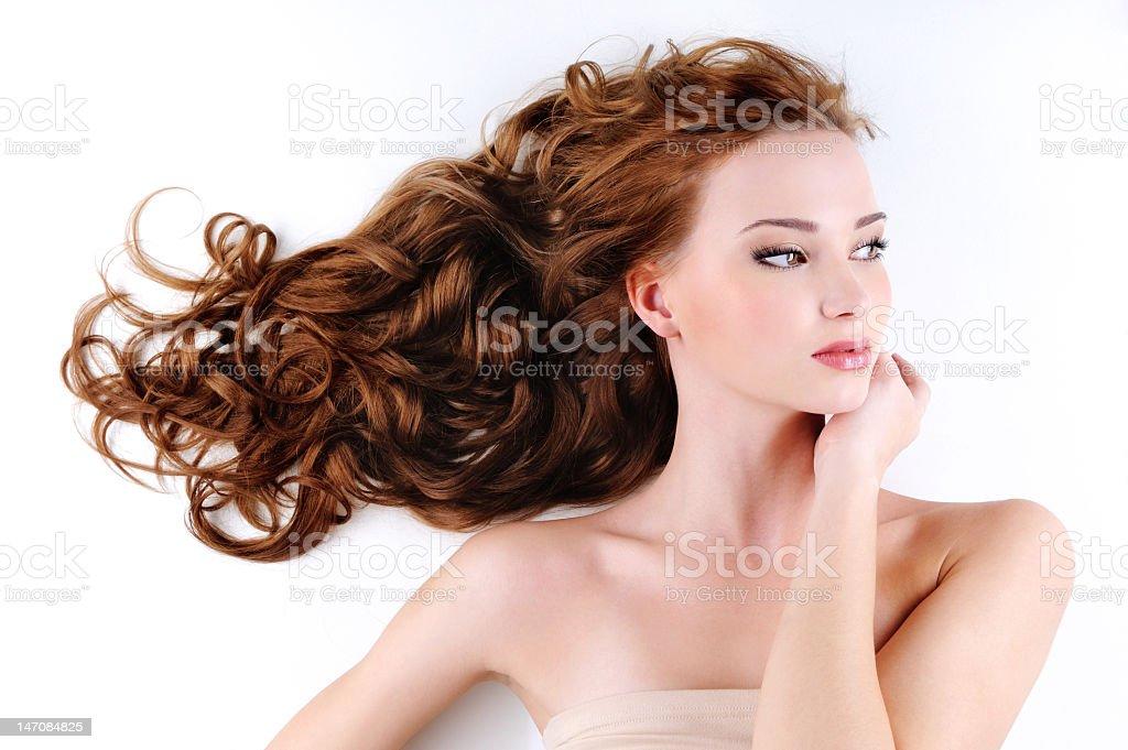beautiful nice woman with long ringlets hairs stock photo