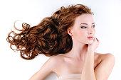 beautiful nice woman with long ringlets hairs