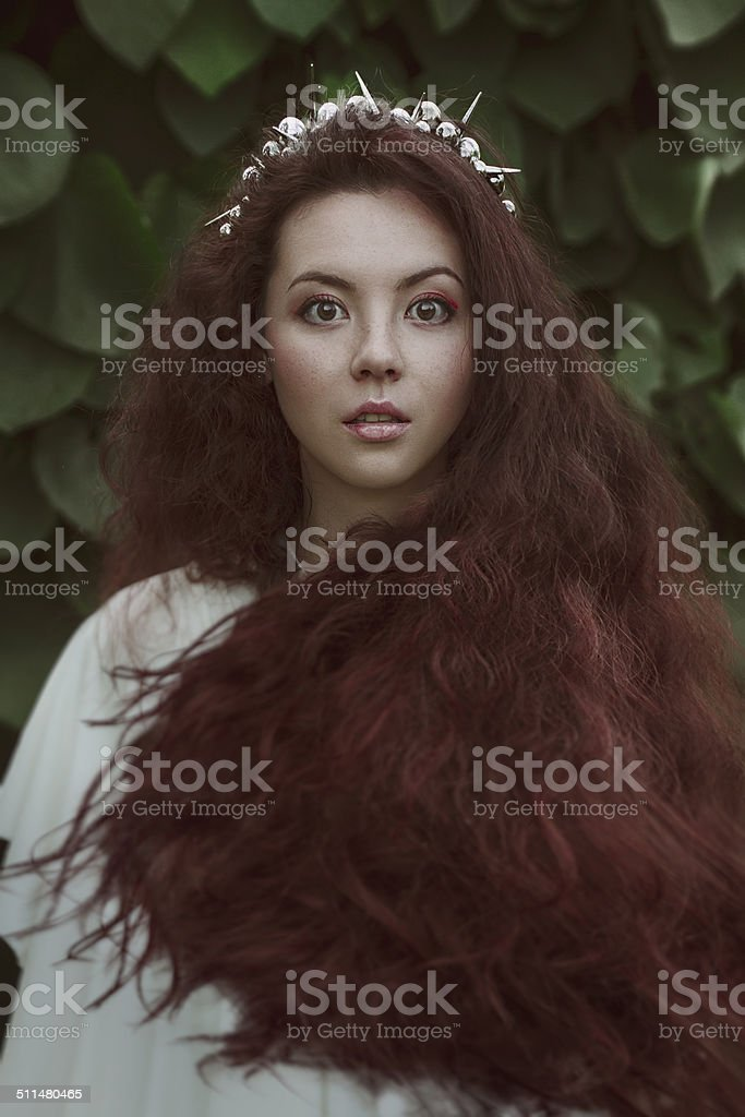 beautiful nice woman with long ringlets hairs stock photo