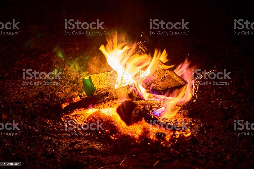Beautiful night bonfire over Lemiet lake in Mazury district, Poland. stock photo